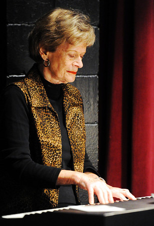 """JMag/T. Rob Brown<br /> Director and pianist Cecie Fritz plays music during a dress rehearsal for the Joplin Little Theatre's """"Let's Swing!"""" The revue is a tribute to the music of the 1940s."""