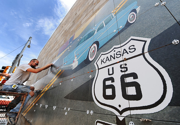 J-Mag/T. Rob Brown<br /> Branden Yost of Joplin, an RC Tile & Hardwoods installer, adds another tile to a Route 66 mural in downtown Galena, Kan., Tuesday afternoon, June 26, 2013. The mural, designed by art director Chris Auckerman and graphic designer Jon White, both with Images in Tile owned by Paul Whitehill, is located at the intersection of 7th and Main streets in Galena.