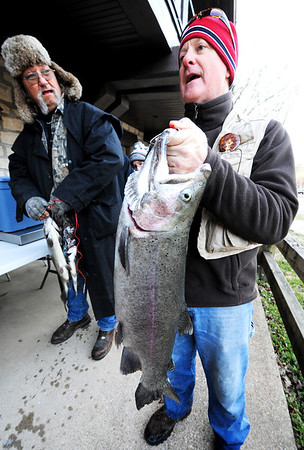 J-Mag/T. Rob Brown<br /> Craig Greer, of Joplin, holds his 7.06-pound trout Thursday morning, March 1, 2012, at Roaring River State Park in Cassville, Mo., as fellow angler Rob Beyer, of Shell Knob, holds his 4.22-pound lunker at the weigh-in station.