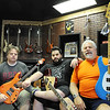 J-Mag/T. Rob Brown<br /> Family owners David, Benji and Ben Peterson with various guitars at Glory Days Music in Joplin. Their new location is at 420 North Range Line Road. Benji is Ben's son. David and Ben are brothers. The row on the wall behind them are bass guitars.