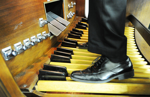 J-Mag/T. Rob Brown<br /> Chris Greninger of Joplin even uses his feet to play a 1987 Baldwin 645 3-manual electronic pipe organ made in Arkansas, which he modified with Conn speakers under the pipes.