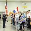 J-Mag/T. Rob Brown<br /> The crowd salutes and puts their hands over their hearts as the Joplin High School JROTC presents the colors during the Patriot's Day Veterans Award Ceremony Wednesday afternoon, Sept. 11, 2013, at the Missouri National Guard Armory on 32nd Street in Joplin. The event was sponsored by the MOAA Four State Chapter in cooperation with the Guard, the Missouri Veterans Association and the state of Missouri.