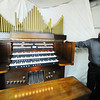 J-Mag/T. Rob Brown<br /> Chris Greninger of Joplin stands next to a 1987 Baldwin 645 3-manual electronic pipe organ made in Arkansas, which he modified with Conn speakers under the pipes.