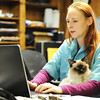 J-Mag/T. Rob Brown<br /> Dr. Michelle Cahill, veterinarian, holds an office cat as she enters records recently.