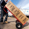 J-Mag/T. Rob Brown<br /> warehouse worker moves donated boxes of cereal at Misti's Mission.