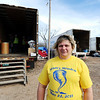 J-Mag/T. Rob Brown<br /> Misti Lindquist stands in the foreground as warehouse workers move donated items at Misti's Mission.