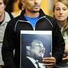 J-Mag/T. Rob Brown<br /> Dantley Harbin, of Joplin, holds a photograph of Martin Luther King Jr. as the crowd listens to members of the Myrtle Lodge No. 149 during a speech following a parade to honor the King's legacy Monday afternoon, Jan. 16, 2012, at the Joplin Public Library. The parade, in honor of the civil rights leader, started at the intersection of Langston Hughes-Broadway and St. Louis Avenue and continued on to the Joplin Public Library.