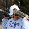 J-Mag/T. Rob Brown<br /> Warehouse worker Christopher Shockley, of Joplin, carries tree limbs away as they clear land for the new warehouse at Misti's Mission.