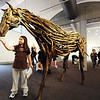 J-Mag/T. Rob Brown<br /> Dayshaya Walker, a Columbia Elementary School third grader, stands under a horse at Spiva Center for the Arts Tuesday afternoon, Jan. 31, 2012. Students on a field trip visited the gallery to see Rachel Wilson's found wood sculptures of horses and other horse-themed art pieces such as collages, etchings and monoprints.