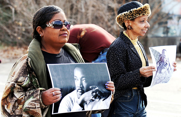 J-Mag/T. Rob Brown<br /> Locals, including Debbie Powell (left), of Joplin, who holds a photo of Martin Luther King Jr., and members of the Myrtle Lodge No. 149 participate in a parade honoring King's legacy Monday afternoon, Jan. 16, 2012, on Langston Hughes-Broadway in downtown Joplin. The parade, in honor of the civil rights leader, started at the intersection of Langston Hughes-Broadway and St. Louis Avenue and continued on to the Joplin Public Library.