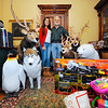 Homeowner Jack Hoover and his daughter Shannon Hoover, 14, stand with animal decorations and a few donated toys at their home on Thursday. Hoover will be hosting his 9th annual open house Toys for Tots fundraiser at his home, the Whitney House, at 127 Merriam Ave. in Leominster on December 13th from 7 p.m. to 9 p.m.<br /> SENTINEL & ENTERPRISE / BRETT CRAWFORD