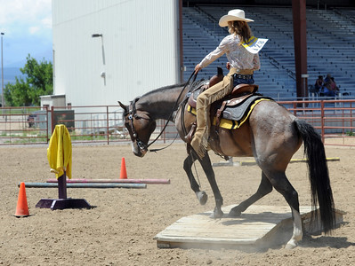 McKayla Lafferty, a former student of Jack Wheeler, competes on the trail ride course. Jack Wheeler, a 75-year-old Erie man who died in February, was very well-known in horse riding circles and among organizers and attendees of the Boulder County Fair. Wheeler was a leader of the Cloverleaf Riders 4-H Club for 45 years and taught many area kids how to ride. His grandsons, daughter and wife and still part of the 4-H club. For more photos and a video of Jack's legacy, go to www.dailycamera.com. or www.timescall.com.  Cliff Grassmick / July 22, 2012
