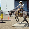 "McKayla Lafferty, a former student of Jack Wheeler, competes on the trail ride course.<br /> Jack Wheeler, a 75-year-old Erie man who died in February, was very well-known in horse riding circles and among organizers and attendees of the Boulder County Fair. Wheeler was a leader of the Cloverleaf Riders 4-H Club for 45 years and taught many area kids how to ride. His grandsons, daughter and wife and still part of the 4-H club.<br /> For more photos and a video of Jack's legacy, go to  <a href=""http://www.dailycamera.com"">http://www.dailycamera.com</a>. or  <a href=""http://www.timescall.com"">http://www.timescall.com</a>.<br />  Cliff Grassmick / July 22, 2012"