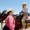 "McKayla Lafferty, right, a former student of Jack Wheeler, shares a laugh with Wheeler's daughter, Dee Jay Smith. Alyssa Olson is on the left.<br /> Jack Wheeler, a 75-year-old Erie man who died in February, was very well-known in horse riding circles and among organizers and attendees of the Boulder County Fair. Wheeler was a leader of the Cloverleaf Riders 4-H Club for 45 years and taught many area kids how to ride. His grandsons, daughter and wife and still part of the 4-H club.<br /> For more photos and a video of Jack's legacy, go to  <a href=""http://www.dailycamera.com"">http://www.dailycamera.com</a>. or  <a href=""http://www.timescall.com"">http://www.timescall.com</a>.<br />  Cliff Grassmick / July 22, 2012"