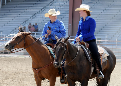J.T. Smith, left,  Jack Wheeler's grandson, and Sabrina Johnson, ride throuh the arena at the Boulder County Fairgrounds. Jack Wheeler, a 75-year-old Erie man who died in February, was very well-known in horse riding circles and among organizers and attendees of the Boulder County Fair. Wheeler was a leader of the Cloverleaf Riders 4-H Club for 45 years and taught many area kids how to ride. His grandsons, daughter and wife and still part of the 4-H club. For more photos and a video of Jack's legacy, go to www.dailycamera.com. or www.timescall.com.  Cliff Grassmick / July 22, 2012