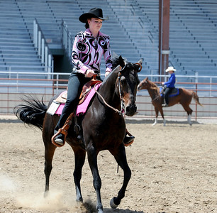 Alyssa Olson is a former student of Jack Wheeler. She is riding in the Easy Riders 4-H show. Jack Wheeler, a 75-year-old Erie man who died in February, was very well-known in horse riding circles and among organizers and attendees of the Boulder County Fair. Wheeler was a leader of the Cloverleaf Riders 4-H Club for 45 years and taught many area kids how to ride. His grandsons, daughter and wife and still part of the 4-H club. For more photos and a video of Jack's legacy, go to www.dailycamera.com. or www.timescall.com.  Cliff Grassmick / July 22, 2012
