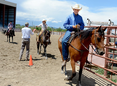 J.T. Smith, right,  Jack Wheeler's grandson, finishes up a ride during the Easy Riders 4-H competition. Alyssa Olson and McKayla Lafferty,  are following behind. Jack Wheeler, a 75-year-old Erie man who died in February, was very well-known in horse riding circles and among organizers and attendees of the Boulder County Fair. Wheeler was a leader of the Cloverleaf Riders 4-H Club for 45 years and taught many area kids how to ride. His grandsons, daughter and wife and still part of the 4-H club. For more photos and a video of Jack's legacy, go to www.dailycamera.com. or www.timescall.com.  Cliff Grassmick / July 22, 2012