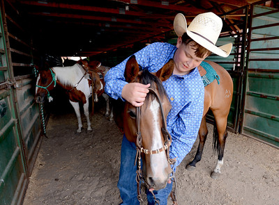 J.T. Smith,  Jack Wheeler's grandson, prepares his horse after competition. Jack Wheeler, a 75-year-old Erie man who died in February, was very well-known in horse riding circles and among organizers and attendees of the Boulder County Fair. Wheeler was a leader of the Cloverleaf Riders 4-H Club for 45 years and taught many area kids how to ride. His grandsons, daughter and wife and still part of the 4-H club. For more photos and a video of Jack's legacy, go to www.dailycamera.com. or www.timescall.com.  Cliff Grassmick / July 22, 2012