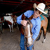 "J.T. Smith,  Jack Wheeler's grandson, prepares his horse after competition.<br /> Jack Wheeler, a 75-year-old Erie man who died in February, was very well-known in horse riding circles and among organizers and attendees of the Boulder County Fair. Wheeler was a leader of the Cloverleaf Riders 4-H Club for 45 years and taught many area kids how to ride. His grandsons, daughter and wife and still part of the 4-H club.<br /> For more photos and a video of Jack's legacy, go to  <a href=""http://www.dailycamera.com"">http://www.dailycamera.com</a>. or  <a href=""http://www.timescall.com"">http://www.timescall.com</a>.<br />  Cliff Grassmick / July 22, 2012"