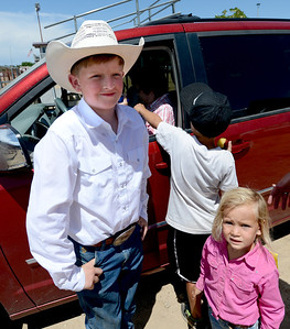 Tristan Smith, Jack Wheeler's grandson, and Paige Lafferty, stop for a photo. Jack Wheeler, a 75-year-old Erie man who died in February, was very well-known in horse riding circles and among organizers and attendees of the Boulder County Fair. Wheeler was a leader of the Cloverleaf Riders 4-H Club for 45 years and taught many area kids how to ride. His grandsons, daughter and wife and still part of the 4-H club. For more photos and a video of Jack's legacy, go to www.dailycamera.com. or www.timescall.com.  Cliff Grassmick / July 22, 2012