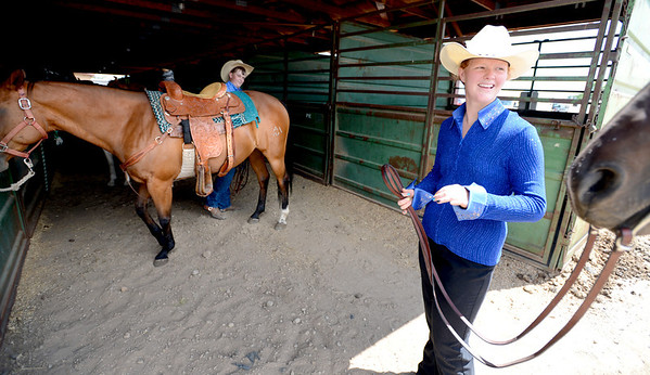 "Sabrina Johnson, right, waits with her horse, while J.T Smith works in the background.<br /> Jack Wheeler, a 75-year-old Erie man who died in February, was very well-known in horse riding circles and among organizers and attendees of the Boulder County Fair. Wheeler was a leader of the Cloverleaf Riders 4-H Club for 45 years and taught many area kids how to ride. His grandsons, daughter and wife and still part of the 4-H club.<br /> For more photos and a video of Jack's legacy, go to  <a href=""http://www.dailycamera.com"">http://www.dailycamera.com</a>. or  <a href=""http://www.timescall.com"">http://www.timescall.com</a>.<br />  Cliff Grassmick / July 22, 2012"