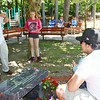 Jose Oliver snaps photos of the new bench in memory of his son, Jeremiah, during the dedication ceremony at Coggshall Park in Fitchburg on Saturday afternoon. SENTINEL & ENTERPRISE / Ashley Green