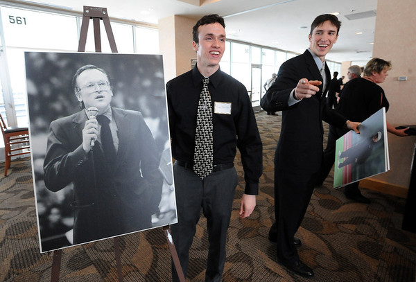 "Robb Quiller, and Rory Quiller, two sons of Jerry Quiller, prepare to move photos of their father at the memorial service.<br /> A memorial service was held at the Byron R. White Stadium Club for former University of Colorado track and field coach, Jerry Quiller. Quiller, who coached at CU from 1985 to 1995, died of cancer at age 69  on February 2, 2012.<br /> For more photos of the memorial, go to  <a href=""http://www.dailycamera.com"">http://www.dailycamera.com</a>.<br /> February 11, 2012 / Cliff Grassmick"