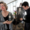 "Sandy Quiller, wife of Jerry Quiller, waits for guests with her son, Robb, who is next to a photo of his father.<br /> A memorial service was held at the Byron R. White Stadium Club for former University of Colorado track and field coach, Jerry Quiller. Quiller, who coached at CU from 1985 to 1995, died of cancer at age 69  on February 2, 2012.<br /> For more photos of the memorial, go to  <a href=""http://www.dailycamera.com"">http://www.dailycamera.com</a>.<br /> February 11, 2012 / Cliff Grassmick"