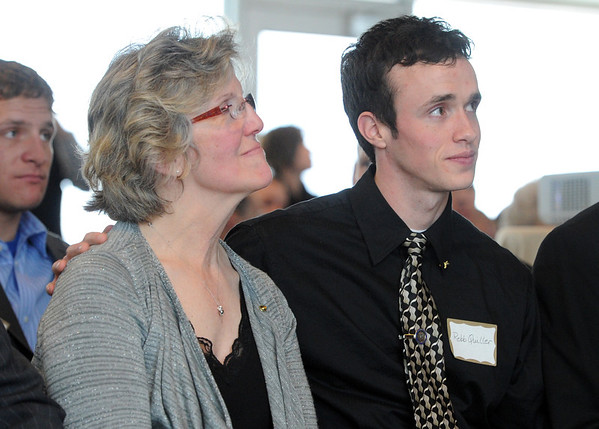 """Sandy Quiller, wife of Jerry, is comforted by her son, Robb, during the memorial service Saturday afternoon.<br /> A memorial service was held at the Byron R. White Stadium Club for former University of Colorado track and field coach, Jerry Quiller. Quiller, who coached at CU from 1985 to 1995, died of cancer at age 69  on February 2, 2012.<br /> For more photos of the memorial, go to  <a href=""""http://www.dailycamera.com"""">http://www.dailycamera.com</a>.<br /> February 11, 2012 / Cliff Grassmick"""