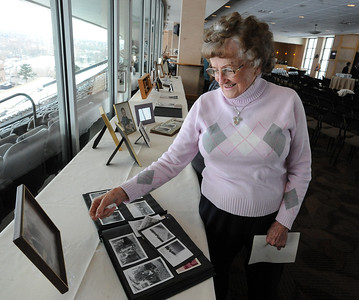 Mary Jane Brown, the aunt of Jerry Quiller, smiles while looking at family photos. A memorial service was held at the Byron R. White Stadium Club for former University of Colorado track and field coach, Jerry Quiller. Quiller, who coached at CU from 1985 to 1995, died of cancer at age 69  on February 2, 2012. For more photos of the memorial, go to www.dailycamera.com. February 11, 2012 / Cliff Grassmick