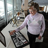"Mary Jane Brown, the aunt of Jerry Quiller, smiles while looking at family photos.<br /> A memorial service was held at the Byron R. White Stadium Club for former University of Colorado track and field coach, Jerry Quiller. Quiller, who coached at CU from 1985 to 1995, died of cancer at age 69  on February 2, 2012.<br /> For more photos of the memorial, go to  <a href=""http://www.dailycamera.com"">http://www.dailycamera.com</a>.<br /> February 11, 2012 / Cliff Grassmick"