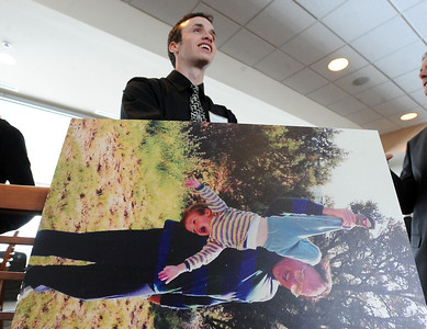 Robb Quiller stands behind a photo of himself as a child with his father, Jerry Quiller. A memorial service was held at the Byron R. White Stadium Club for former University of Colorado track and field coach, Jerry Quiller. Quiller, who coached at CU from 1985 to 1995, died of cancer at age 69  on February 2, 2012. For more photos of the memorial, go to www.dailycamera.com. February 11, 2012 / Cliff Grassmick