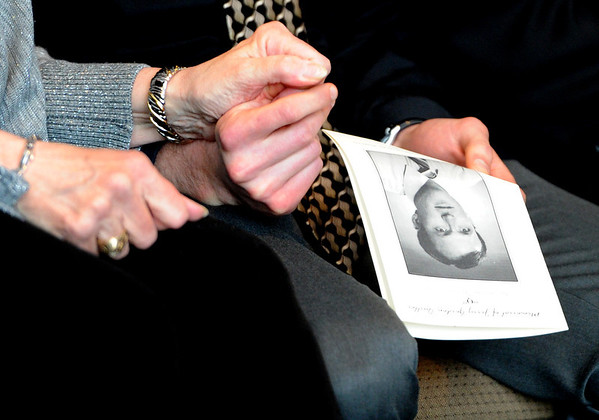 "Sandy Quiller, wife of Jerry, holds the hand of her son, Robb, during the ceremony.<br /> A memorial service was held at the Byron R. White Stadium Club for former University of Colorado track and field coach, Jerry Quiller. Quiller, who coached at CU from 1985 to 1995, died of cancer at age 69  on February 2, 2012.<br /> For more photos of the memorial, go to  <a href=""http://www.dailycamera.com"">http://www.dailycamera.com</a>.<br /> February 11, 2012 / Cliff Grassmick"