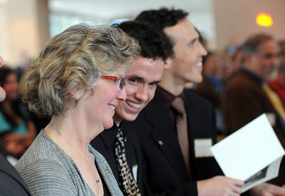 """Sandy Quiller, wife of coach """"Q"""", shares a lighter moment with her son, Robb, during the ceremony. A memorial service was held at the Byron R. White Stadium Club for former University of Colorado track and field coach, Jerry Quiller. Quiller, who coached at CU from 1985 to 1995, died of cancer at age 69  on February 2, 2012. For more photos of the memorial, go to www.dailycamera.com. February 11, 2012 / Cliff Grassmick"""