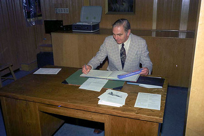 Jim Smythe signing the baptismal register at Christ Church, Calgary : Sunday 24 April 1977