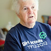 Joan Webber talks about her experience with the Girl Scouts in her Ashburnham home on Wednesday afternoon. Webber has been a member of the Girl Scouts since 1946 and recently received her 65 year pin. SENTINEL & ENTERPRISE / Ashley Green