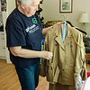 Joan Webber shows off a replica uniform of Juliette Low's, the founder of Girl Scouts, in her Ashburnham home on Wednesday afternoon. Webber has been a member of the Girl Scouts since 1946 and recently received her 65 year pin. SENTINEL & ENTERPRISE / Ashley Green