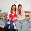 Joe Poirier of Leominster talks about his father Ron Poirier who was deported to Cananda in 2011, while seated with his fiance Kelley Casey and their daughter Alaynah Rose Poirier, 13-months-old, in Ron's parents house in Leominster, Friday.<br /> SENTINEL & ENTERPRISE / BRETT CRAWFORD