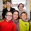 Maria Joffrion is surrounded by her children in the kitchen of their Leominster home on Wednesday afternoon. Back row, Ben, 14, Lucia, 12; front, Tommy, 10 and Sean 8. SENTINEL & ENTERPRISE / Ashley Green