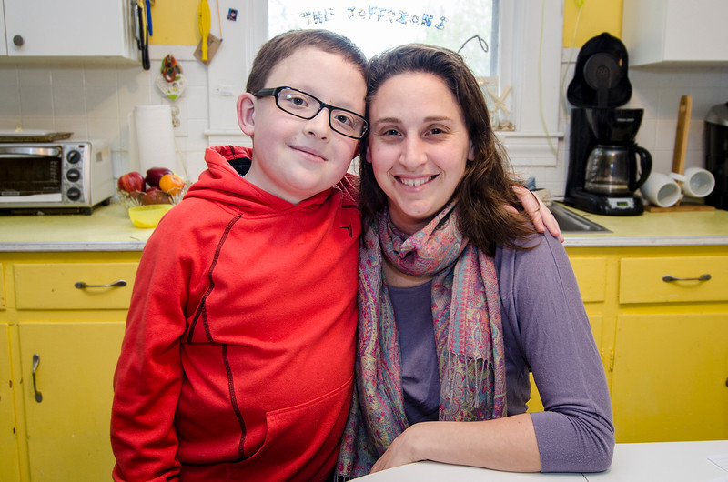 10-year-old Tommy Joffrion snuggles up to mom Maria in the family kitchen on Wednesday afternoon. Tommy is battling Optic Pathway/Chiasm Glioma and Chronic Myeloid Leukemia. SENTINEL & ENTERPRISE / Ashley Green