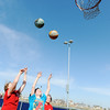 Globe/T. Rob Brown<br /> Basketball players (from left) Kaylan Watts, 10, Evan Bilke, 9, and Travis Brown, 9, aim for the hoop Thursday afternoon, March 14, 2013, at Cunningham Park in Joplin. They are members of the New Creation Church KidsQuest afterschool program.