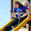 Globe/T. Rob Brown<br /> Cheyanne Corrigan, freshman Ozark Christian College student, helps 8-year-old Haleigh Hunt down a slide Thursday afternoon, March 14, 2013, at Cunningham Park in Joplin. Hunt is a member of the New Creation Church KidsQuest afterschool program and Corrigan is a volunteer assistant.