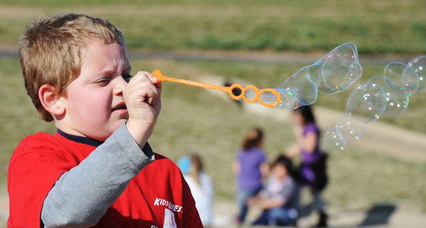 Globe/T. Rob Brown<br /> Seven-year-old Carson Harrison, of Joplin, makes bubbles Thursday afternoon, March 14, 2013, at Cunningham Park in Joplin. Harrison is a member of the New Creation Church KidsQuest afterschool program.