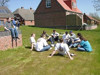 Yet another after-mission Pilot Debrief. The weather was still gorgeous. I am the only one with long hair. Wirdum, Germany; May 2001