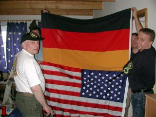 German and american flags together. I am peeking from behind the flags on the right of the picture. Wirdum, Germany; May 2001