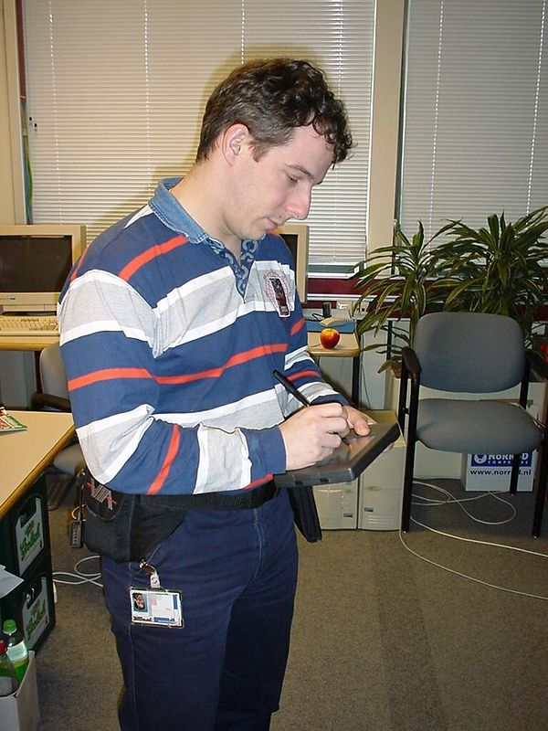 I love my gadgets. Here I am wearing a PC, the VIA PC II, a wearable computer with a P2-400, 128MB RAM, 20GB harddisk and VGA touch screen