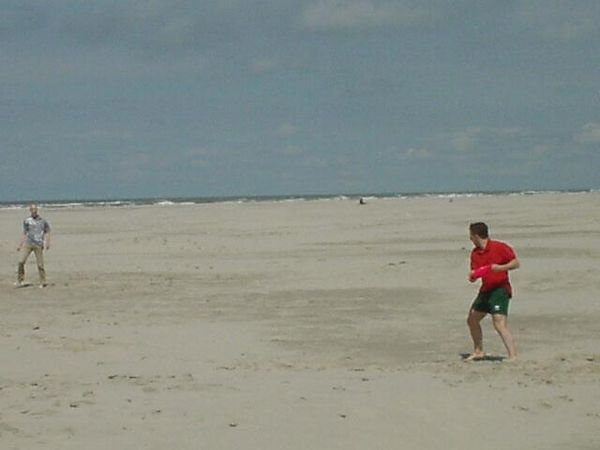 "Frisbee! With Jan Sipke on <a href=""http://dreams.smugmug.com/gallery/1859"">Schiermonnikoog</a> (widest beach in Europe!)"