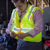 Justin Krook, president of Viz Reflectives of North America, shows off the photoluminescence reflective material in his construction vests. SENTINEL & ENTERPRISE / Ashley Green
