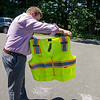 Justin Krook, president of Viz Reflectives of North America, soaks the photoluminescence reflective material with sunsine. SENTINEL & ENTERPRISE / Ashley Green