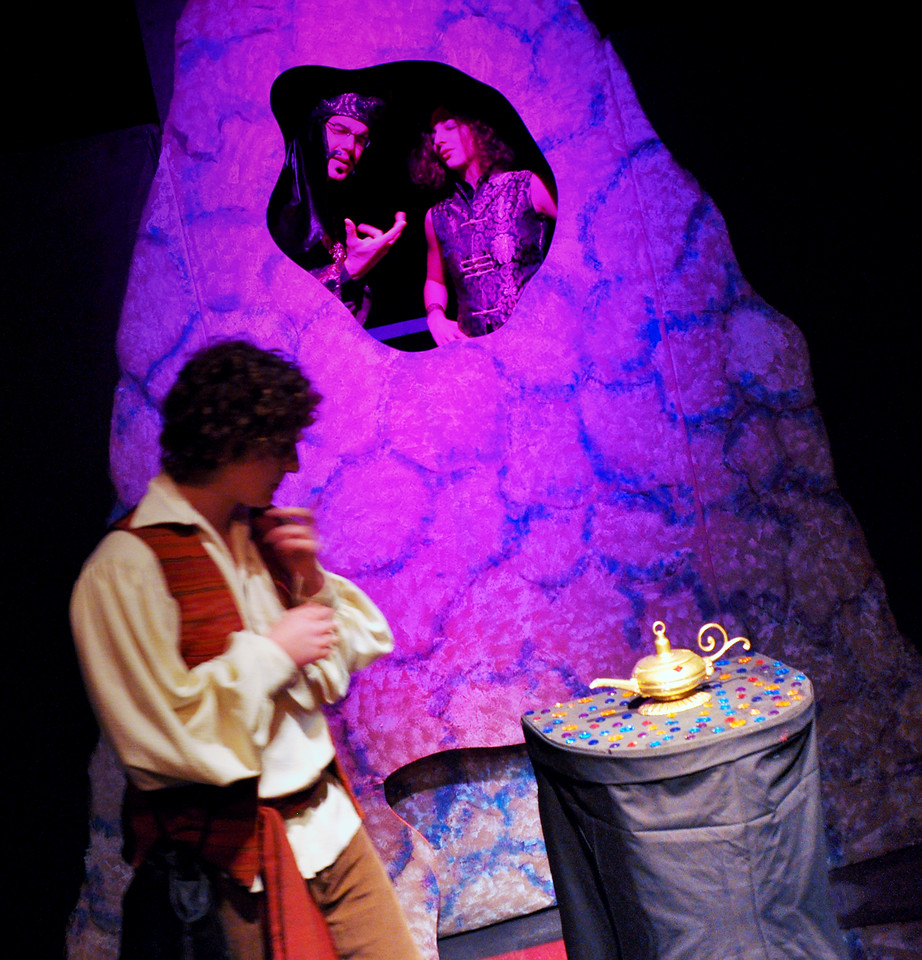 Aladdin reluctantly considers the lamp while Abanaza and Won Tun encourage him.<br /> Spencer Padfield, David Atos, Carly Derderian